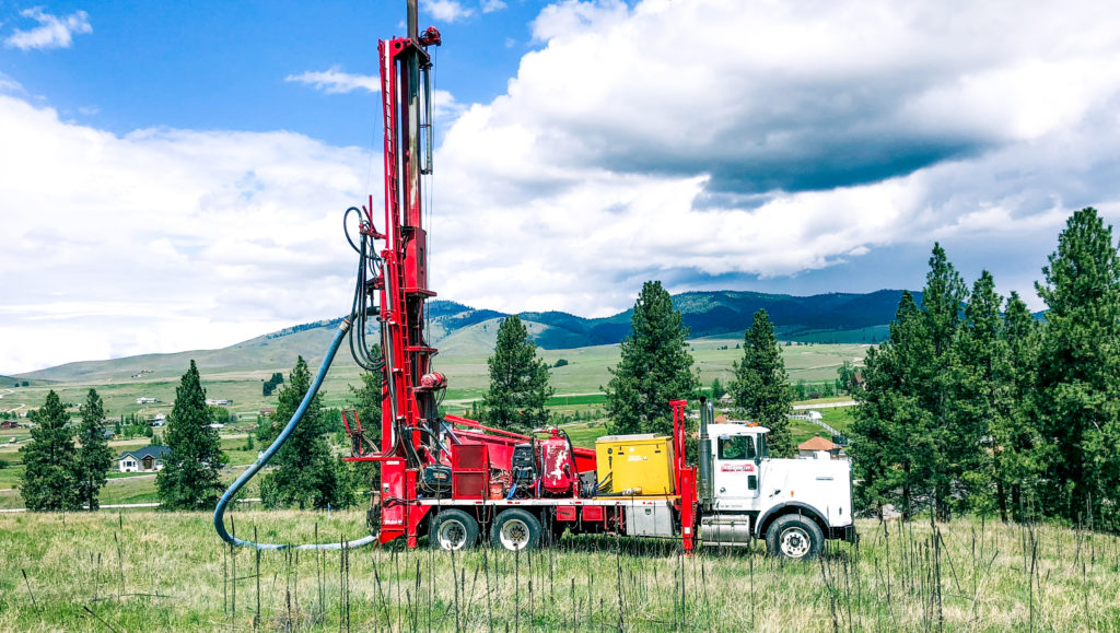 24 inch dual rotary drill parked in Montana field
